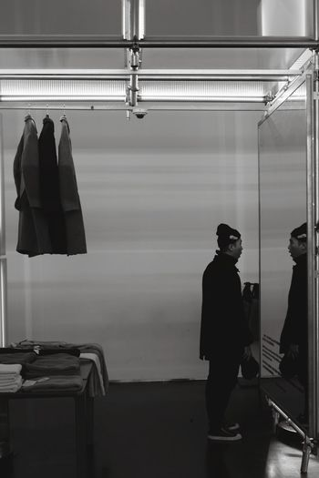 Full length of man reflecting on mirror
