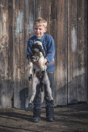 Full length portrait of boy with dog