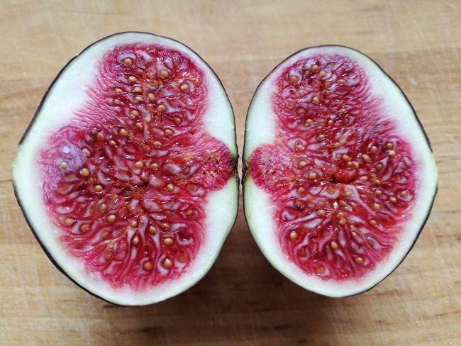 I couldn't give a fig about it Fruit Photography Fruits Inside Photography Healthy Eating Fruit Cross Section Food And Drink Halved Freshness Wood - Material No People Food High Angle View Close-up