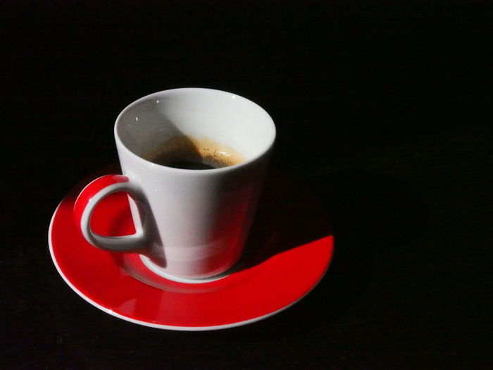 Black And Red Black Background Cafe Time Close-up Coffee - Drink Coffee Cup Day Drink Food And Drink Freshness Indoors  Light And Shadow No People Refreshment Saucer Studio Shot Table