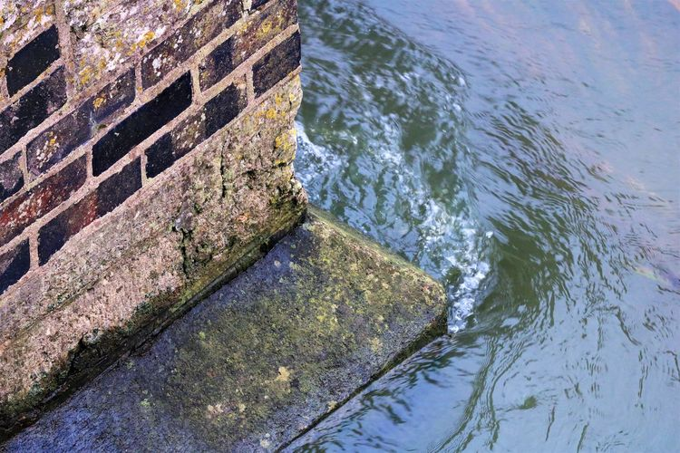 Water on the Corner Bridge Pillar Bubbles Flowing Water Ripples Architecture Built Structure Corner Day High Angle View Moss Nature No People Outdoors Stone Water