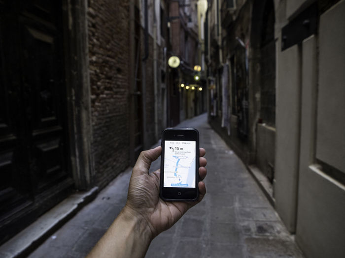 Never get lost Global Positioning System Satellite Navigation At Dusk Walking Around Venice, Italy In Venice Smartphone Holding A Phone