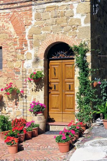 Toscana ITALY Toscane, Arch Architecture Building Exterior Built Structure Door Entrance Entry Flower Plant Potted Plant Tuscany, Italy