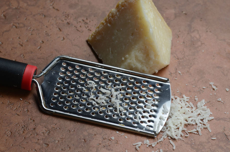 chunk of hard parmesan cheese for grating Cheese Close-up Day Food Freshness Gourmet Cooking Grated Cheese Grated Parmesan Indoors  Italian Food Label No People Parmesan Parmesan Cheese Preparation