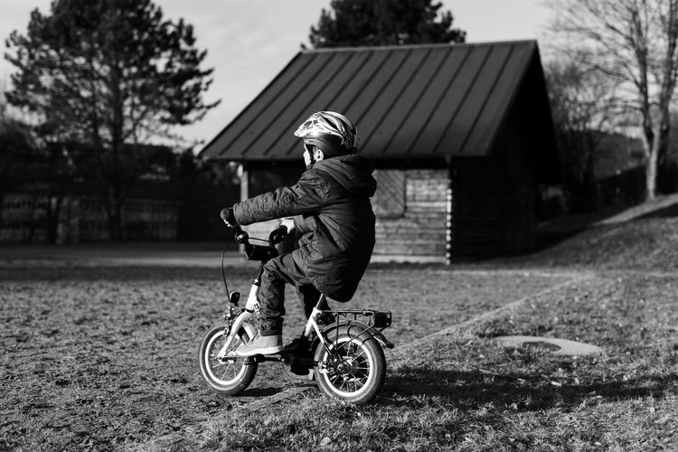 Architecture Bicycle Black & White Black And White Blackandwhite Building Exterior Childhood Day Focus On Foreground Full Length Headwear Helmet One Person Outdoors People Real People