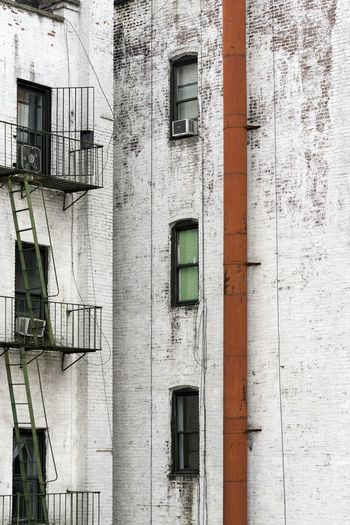 Sticking out like sore thumb. NYC Photography Urban Photography White Building Windows Fire Escape Exhaust Pipe Out Of Place  NYC Sony A6000 365project