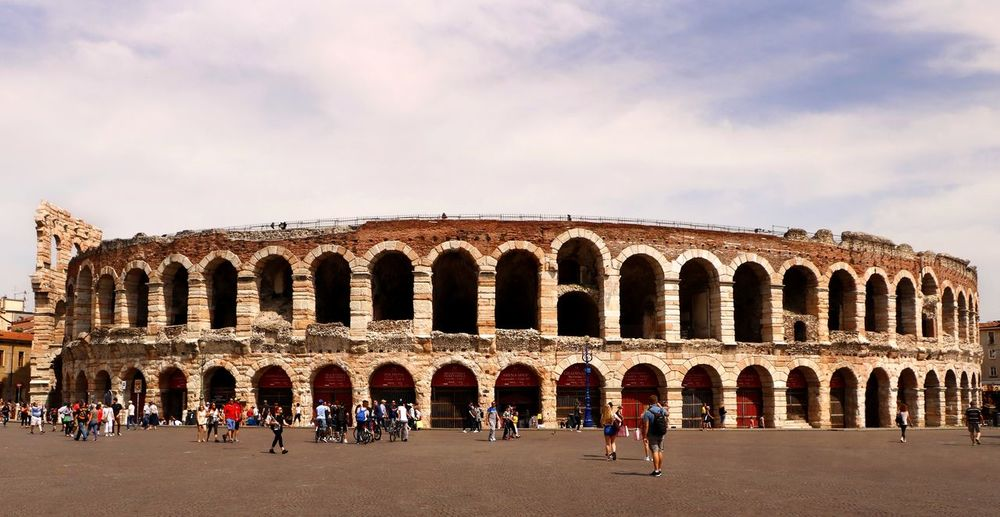 Crowds congregate around the historical roman arena in the centre of Verona, Italy Arena Tourist Attraction  Travel Travel Photography Ancient Ancient Civilization Arch Archaeology Architecture Arena Di Verona Building Exterior Built Structure Crowd Group Of People History Large Group Of People Nature Real People Roman Architecture The Past Tourism Tourist Tourist Destination Travel Visit