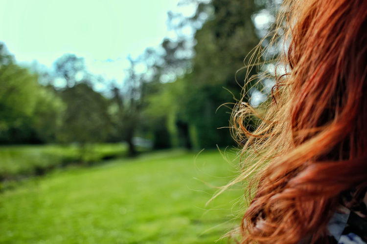 Close-Up Of Woman With Redhead On Field