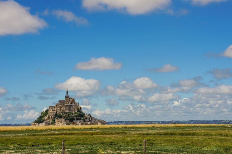 Distant View Of Mont St Michel Against Sky