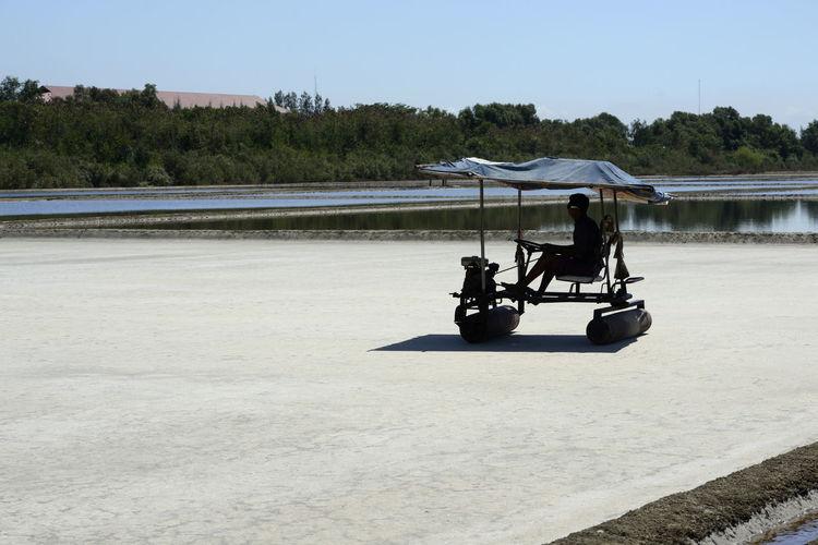 Man driving vehicle on salt flat