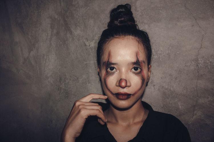 Portrait of teenage girl against wall