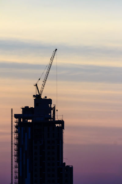 Beautiful silhouette of construction tower cranes with sunset sky background. Silhouette of the building construction with the tower cranes on top under the dramatic sky background. Building Construction Site Construction Construction Site Construction Machinery Silhouette Tower Crane Architecture Building Construction Building Exterior Built Structure City Cloud - Sky Condominium Construction Industry Construction Work Day Low Angle View Nature No People Outdoors Silhouette Silhouettes Of A City Sky Skyscape Skyscraper Sunset Sunset Sky Sunset Sky And Clouds Sunset Sky Colorful Tower Crane Boom Tower Cranes In The Background