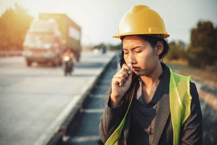 Engineer smelling medicine at construction site