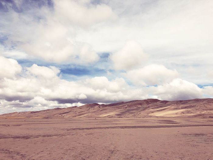 Sand Dune Sand Cloud - Sky Sky Scenics - Nature Environment Landscape Tranquility Non-urban Scene Land Tranquil Scene Beauty In Nature Desert Nature Day Climate Arid Climate Remote No People Mountain Extreme Terrain Barren