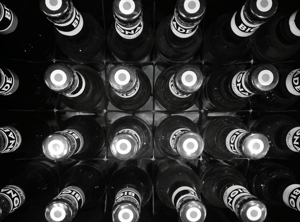 bottle, repetition, large group of objects, full frame, backgrounds, in a row, indoors, alcohol, shelf, arrangement, no people, abundance, wine rack, pattern, day, close-up