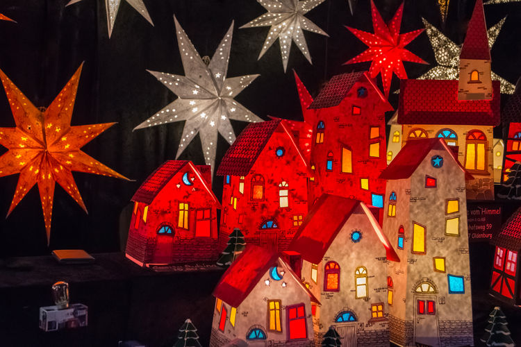 Weihnachtshäuser / Christmas Houses Advent Christmas Houses Christmas Star Christmas Stars Joyeux Noël Joyful Sterne  Black Background Celebration Christmas Christmas Decoration Christmas Ornament Close-up Illuminated Joy Multi Colored Night No People Red Stars Weihnachtsstern