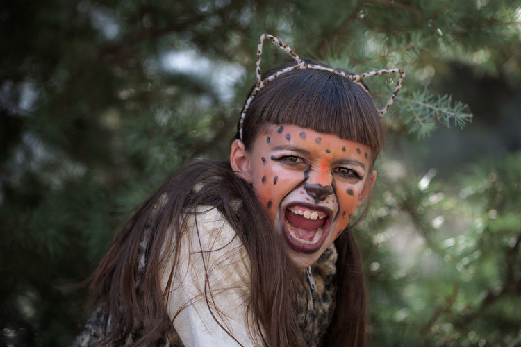 Portrait Headshot Looking At Camera Emotion One Person Happiness Hairstyle Celebration Costume Spooky Brown Hair Mouth Open Cheetah Halloween