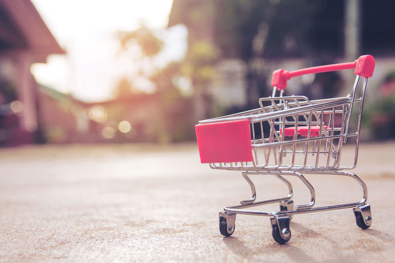 Close-up of empty miniature shopping cart