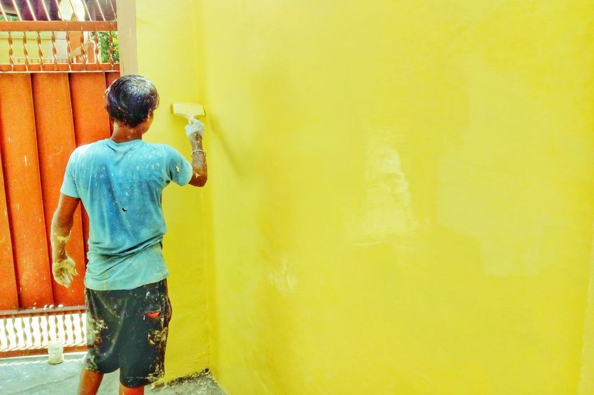 Paint The Town Yellow One Person Yellow Rear View One Man Only Casual Clothing Real People Standing Building Exterior Architecture Paint Brush Outdoors Architecture Mobilephotography Mobile Photography Colored Background Yellow Background MotoE Built Structure