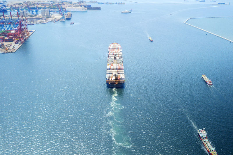 Aerial view of container ship sailing on sea