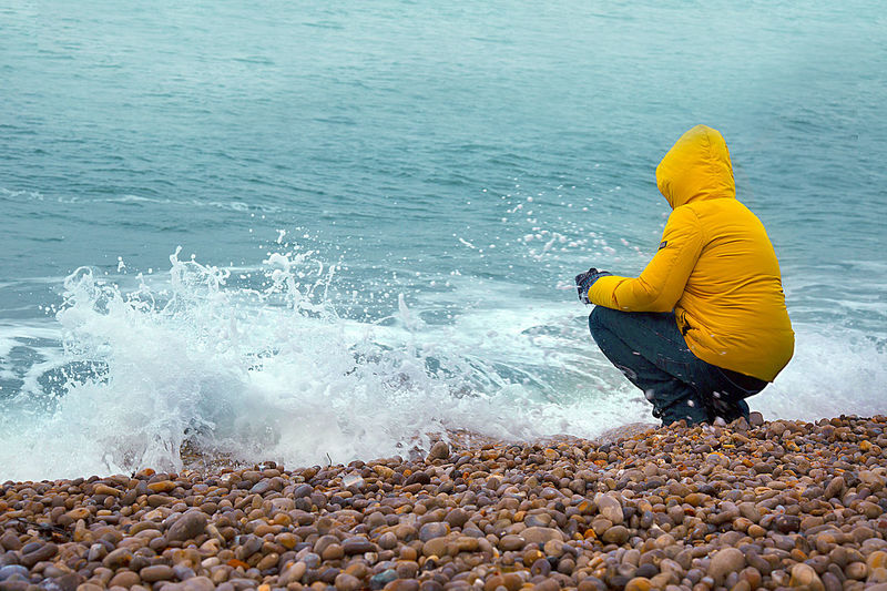 Winter Yellow Jacket Beach Beauty In Nature Nature One Person Outdoors Sea Water Wave