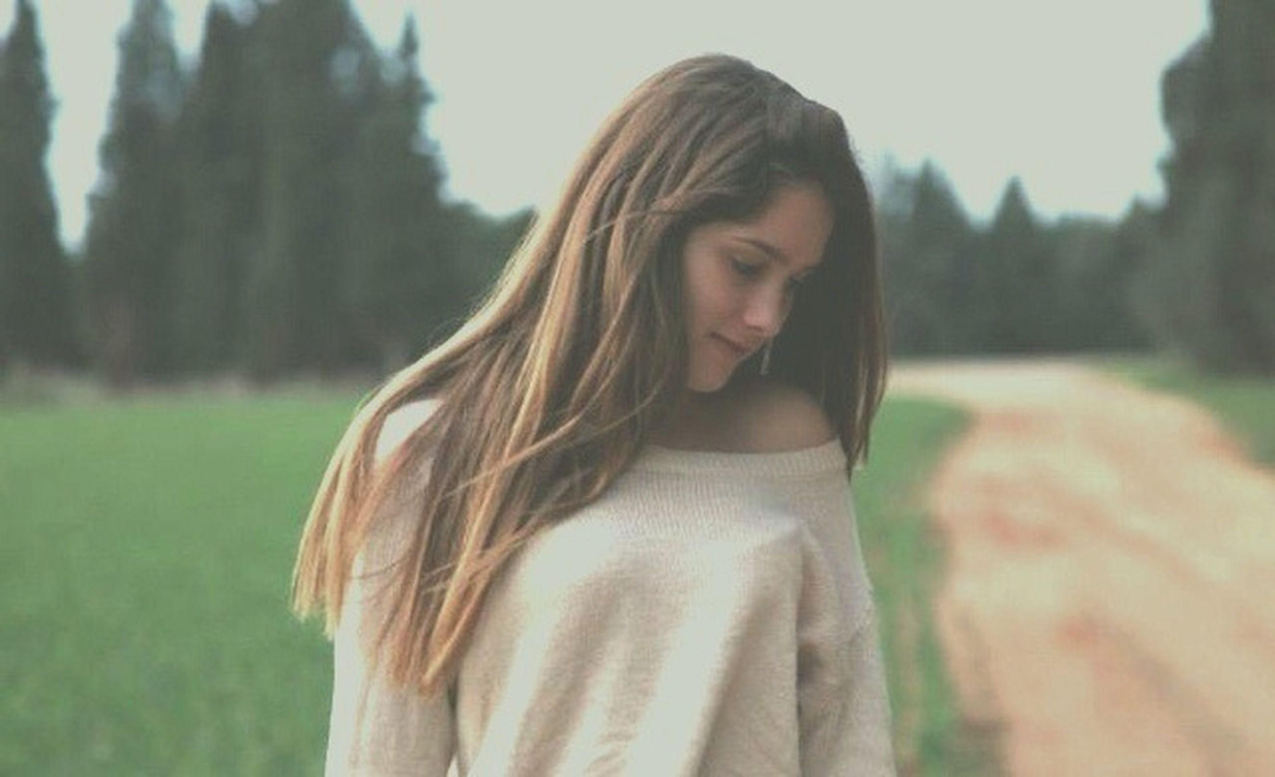 young adult, long hair, young women, person, focus on foreground, lifestyles, leisure activity, casual clothing, portrait, front view, looking at camera, waist up, brown hair, headshot, standing, smiling, medium-length hair