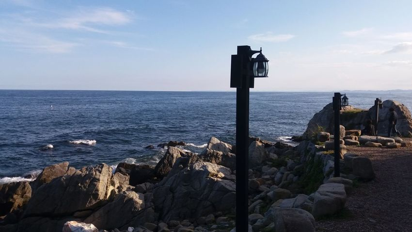 Sea Horizon Over Water Outdoors Beach No People Tranquility Day Water Sky Lighthouse Groyne Nature Gyeongsangbukdo Connected By Travel Lost In The Landscape EyeEmNewHere Rock - Object Scenics Tranquil Scene Beauty In Nature Cloud - Sky