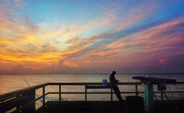 Waiting for fish Sunrise_sunsets_aroundworld Check This Out Sunrise Pier Fisherman