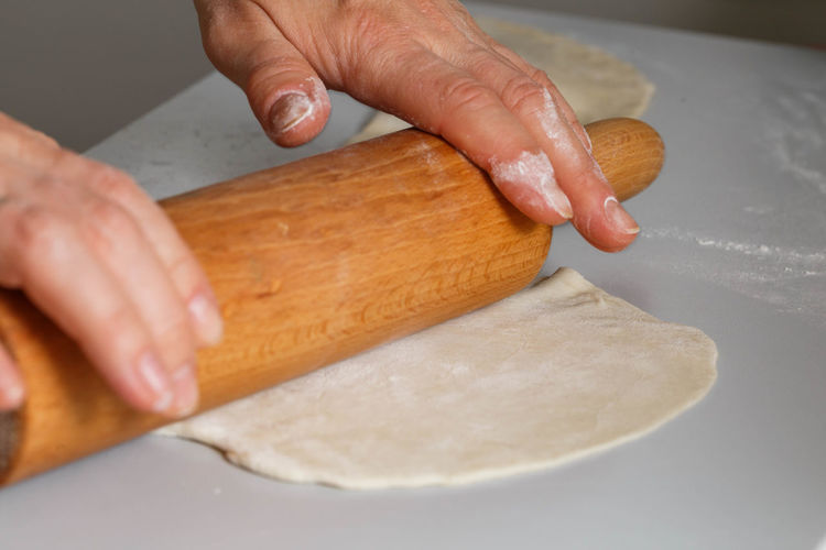 Close-up Cutting Board Dough Flour Food Food And Drink Freshness Holding Homemade Human Body Part Human Hand Indoors  Italian Food Kitchen Kneading Lifestyles Making Men One Person Preparation  Preparing Food Raw Food Real People Rolling Pin Table