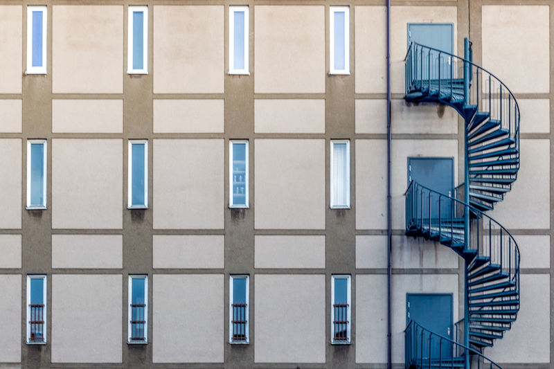 Apartment Architecture Building Building Exterior Built Structure City Day Fire Escape In A Row Low Angle View No People Outdoors Railing Safety Staircase Steps And Staircases Wall - Building Feature Window