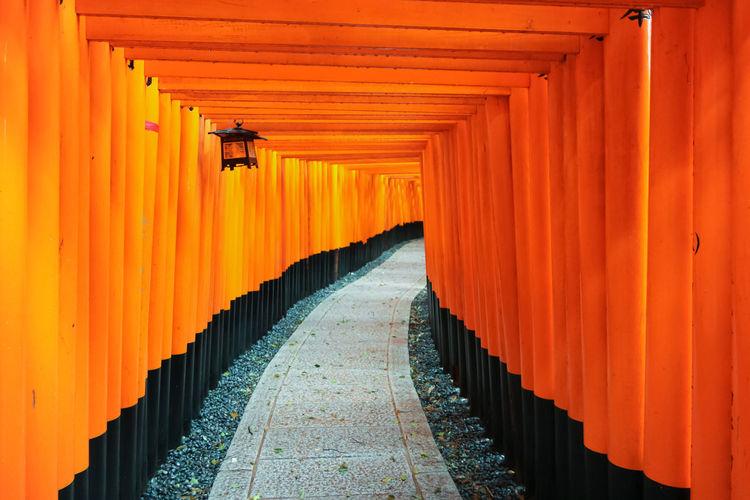 Orange shrine along empty footpath