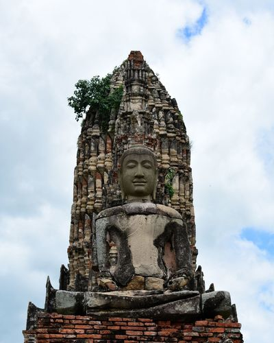 An ancient stone statue in Ayutthaya, Thailand. Wat Chaiwatthanaram. Architecture Statue Religion Built Structure Building Exterior Place Of Worship Old Ruin Travel Destinations Ancient Civilization Human Body Part Sky Spirituality Human Face Solo Travel Outdoors Sculpture Togetherness Line Up Travel Photography Wanderlust Ayutthaya Budha Travel Experience Thailand Wat Chaiwatthanaram