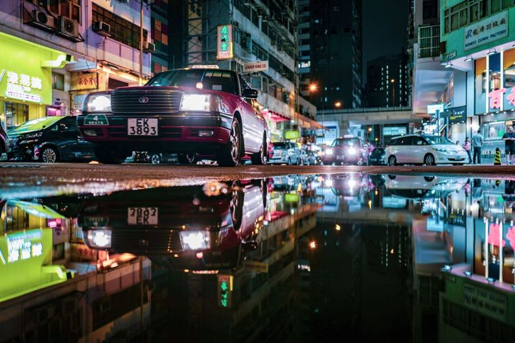 Reflection Shadow And Light Reframinghk Discoverhongkong Street Photography City Building Exterior Architecture Night Built Structure Illuminated Transportation Street City Street Reflection Water Motor Vehicle Motion Travel Destinations Car Building Land Vehicle Office Building Exterior Mode Of Transportation City Life