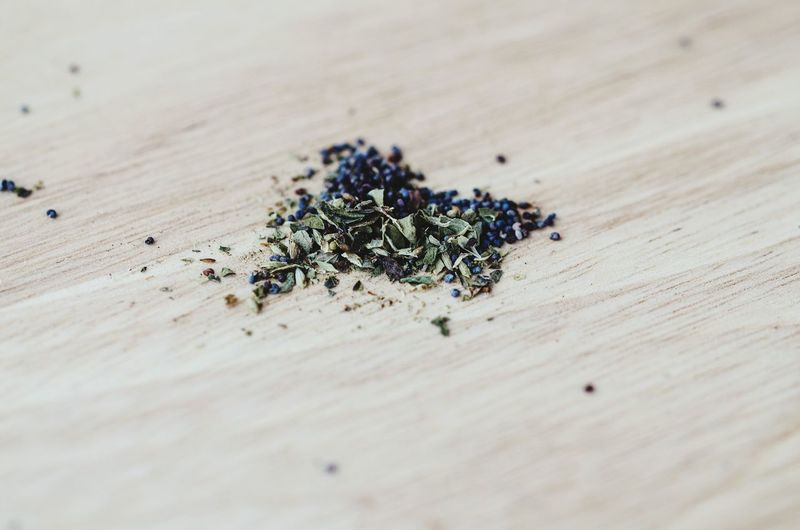Oregano and poppy seeds on wooden table