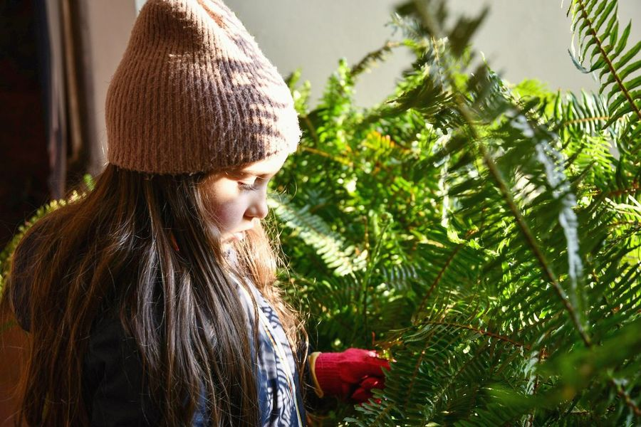 little girl portrait Long Haired Girl Green Plants Winter Garden Potted Plants Natural Light Portrait Tranquil Scene Girl And Plants Children Only Child One Person Childhood One Girl Only People Brown Hair Outdoors Day Portrait Nature Close-up Inner Power Capture Tomorrow
