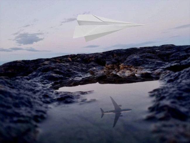 Air Vehicle Airplane Cloud - Sky Environment Flying Freedom Mid-air Mode Of Transportation Motion Nature Nautical Vessel No People Outdoors Paper Boat Sea Sky Transportation Travel Water Waterfront