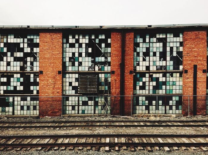 Old Rugged Railroad Crossing. Vintage Vantage. Architecture Building Exterior Built Structure Brick Wall Day Outdoors Window No People Sky