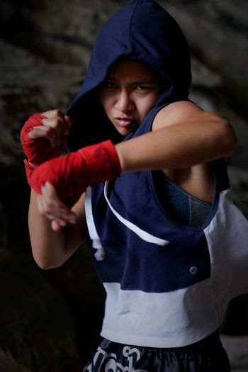 Portrait of girl practicing boxing