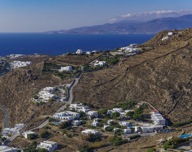 Mykonos, Greece white houses on a hill. External day view of traditional houses at new port district overlooking Aegean sea. Aegean Sea View Architecture GREECE ♥♥ Greek Greek Islands Greek Culture Greek Sky Mediterranean  Mykonos Hill Houses Mykonos Town Mykonos Whitewashed Houses Travel Greece Greece Islands Greek Food Greek Island Architecture Greek Island Houses Greek Island Landscape Greek Island Panorama Greek Nature Greek Sea Greek Village Mykonos Traditional Cyclades Houses Whitewashed