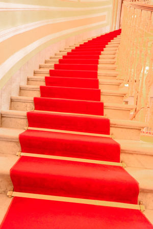 Architectural image inside of a luxury building with the red carpet stairs Genova Luxury Hotel Architectural Detail Architecture Classic Elegance In A Row Indoors  Italy Luxury Marble Staircase Marble Stairs No People Red Red Carpet Red Carpet Stairs Spiral Staircase Stairs Steps Steps And Staircases