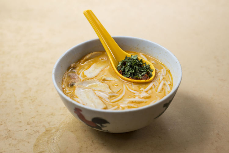 High angle view of laksa in bowl on table