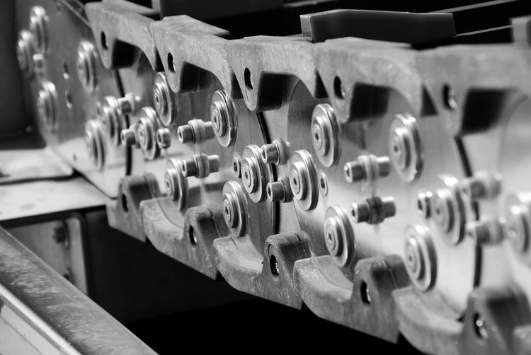 a steel chain conveyor system for controlling Abundance Arrangement Backgrounds Business Close Up Close-up Collection Container Depth Of Field Detail Directly Above Full Frame Indoors  Large Group Of Objects Music No People Occupation Order Selective Focus Side By Side Working