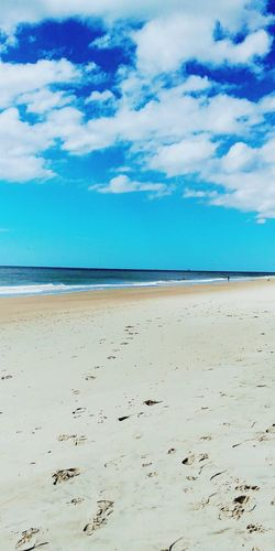 Beach Sand Vacations Sky Beauty In Nature Escape Reflection Relaxing Ocean Isle, NC Blue Sea Landscape Scenics Travel Destinations Cloud - Sky Horizon Over Water Tourism Outdoors Nature Pastel Colored Low Tide Wave Day Red