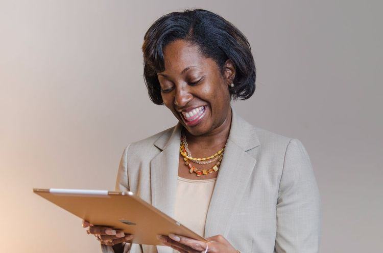 Tablet Ipad Businesspeople Businesswoman Business Black Woman Ethnic African American EyeEm Selects One Person Senior Adult Holding Cheerful Smiling Real People Women Happiness Studio Shot One Woman Only One Senior Woman Only Only Women Wireless Technology Adult Day Close-up Indoors  Adults Only