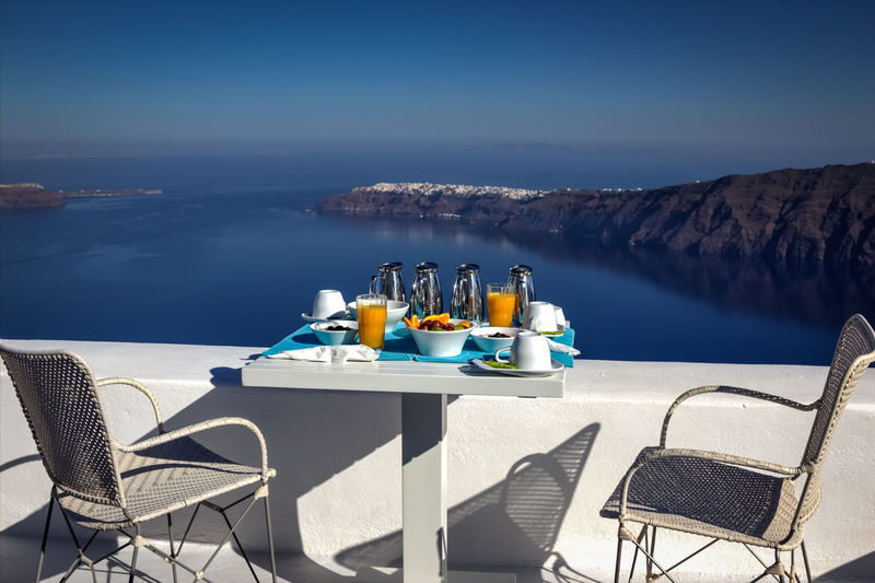 Chairs And Table Against Calm Blue Sea