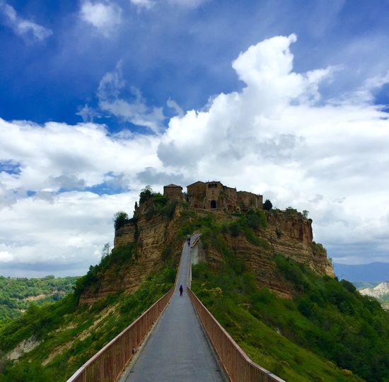 spectacular place! Travel Travel Photography Wonderful Ancient Ancient Civilization Architecture Beauty In Nature Building Exterior Built Structure Castle Civita Di Bagnoregio Cloud - Sky Day Heritage Unesc History Italy Mountain Nature No People Outdoors Photography Scenics Sky The Way Forward Travel Destinations