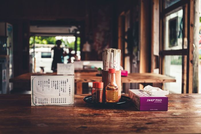 Container Text Communication Table Western Script Indoors  Bottle Wood - Material Glass - Material Still Life Information Restaurant Food And Drink Summer Road Tripping