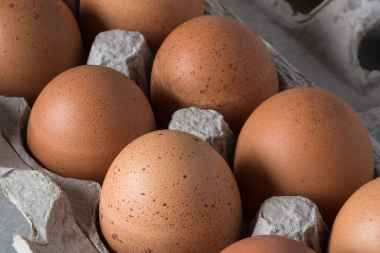 Close-Up Of Brown Eggs In Tray
