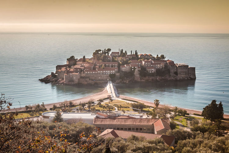 Sveti Stefan island in Montenegro Budva Sveti Stefan Water Architecture Built Structure Sea Building Exterior Horizon Over Water Sky Horizon Nature Building Scenics - Nature No People Travel Destinations History The Past Land High Angle View Beauty In Nature Travel Outdoors