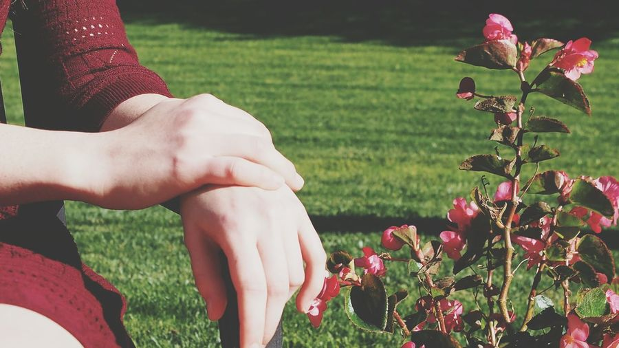 Close-Up Of Womans's Hands Outdoors